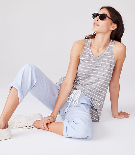 Our designers were drawn to the softness, unbeatable sheen and natural fibers of this linen fabric. Crew neck. Sleeveless. Racerback. Shirttail hem.