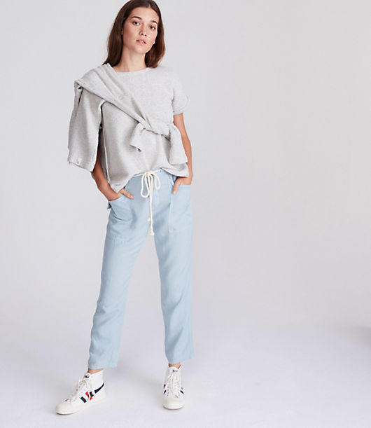 In a breezy soft linen and lyocell blend, this drawstring pair is effortlessly cool and ready to go - anywhere and everywhere. Elasticized drawstring waist. Button fly. Slash patch pockets. Back patch pockets. 27inch inseam.