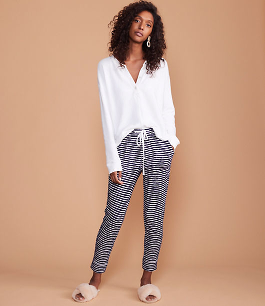 Softly textured stripes line up this soft cotton pair, cut with a relaxed fit and tapered leg. Elasticized drawstring waist. Slash patch pockets. 26 1/2inch inseam.