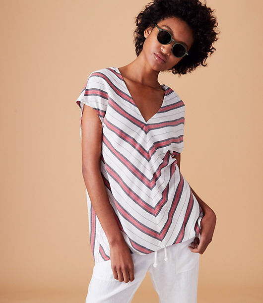 In cool chevron stripes, we designed this easy essential with a clean V-neck and V back for a fresh take. Cap dolman sleeves. Side slits. Shirttail hem.