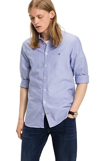 Tommy Hilfiger Men's Shirt. Woven From Premium Cotton, We Present Your Staple Pinstripe Shirt In Our Slimmest Fit. Slim Fit (Our Slimmest Fitting Shirt). 100% Cotton. Button Down Collar. Machine Washable. Imported
