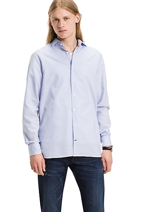Tommy Hilfiger Men's Shirt. Woven From Premium Cotton In A Subtle Dobby Wave, We Present Our Best-Selling Shirt Silhouette In A Goes-With-Everything Color. New York Fit (Larger Than Slim Fit, Slimmer Than Regular Fit). 100% Cotton. Spread Collar. Machine Washable. Imported.