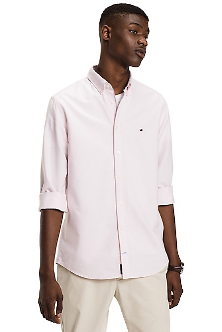 Tommy Hilfiger Men's Shirt. The Classic Oxford Is A Staple Shirt Every Guy Must Own. Woven From Premium Cotton, Cut In Our Best-Selling Fit. New York Fit (Larger Than Slim Fit, Slimmer Than Regular Fit). 100% Cotton. Button-Down Collar. Machine Washable. Imported.