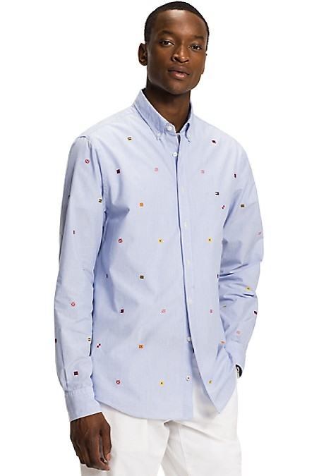 Tommy Hilfiger Men's Shirt. Our Pinstripe Shirt Is Cut To Perfection And Defined By Our Signature Flag Embroidery. Regular Fit (Cut Slightly Larger In The Chest And Shoulders Than Our Slim Fit). 100% Cotton. Button Collar, Flag Embroidery. Machine Washable. Imported.