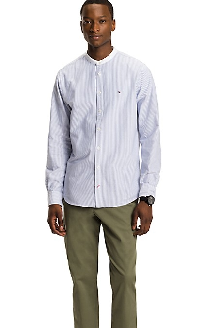 Tommy Hilfiger Men's Shirt. Our Perfectly-Cut Cotton Oxford With A Mandarin Collar-An Easy Choice To Dress Up Or Down. Regular Fit - Cut Slightly Larger In The Chest And Shoulders Than Our Slim Fit. 100% Cotton. Mandarin Collar. Machine Washable. Imported.