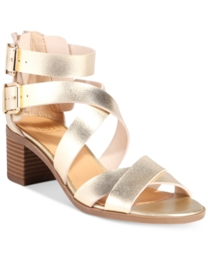 Look tres chic on your day in the city with the vintage-inspired crisscross straps and block heel styling of Material Girl's Danee sandals. (Clearance)