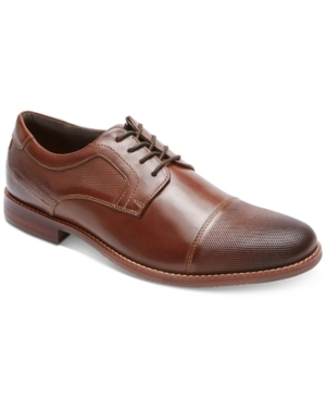 The burnished toe of these classic Oxfords by Rockport add the perfect detail to finish off your professional look.