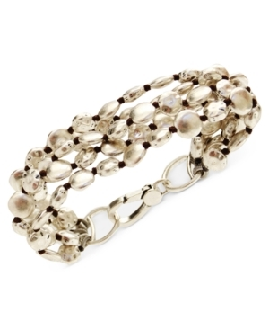 Wherever you go, make a stunning entrance in this gorgeous, gleaming flex bracelet from Lucky Brand. Crafted in silver-tone mixed metal. Approximate length: 7-6/10 inches.