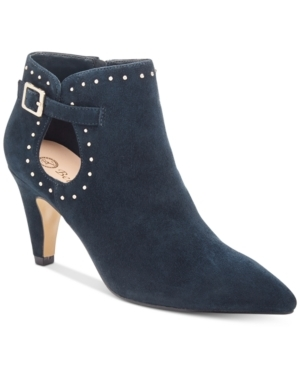 A pointed toe and feminine tapered heel lifts you to the height of fashion in the Delfina booties by Bella Vita. Studs trim sweet side notches closed with strap and buckle detail.